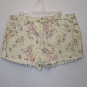 High waisted cream colored shorts with flowers